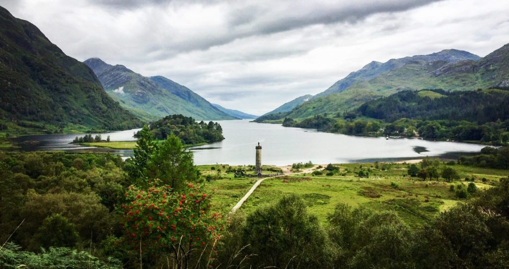 View of Glenfinnan Monument at the head of Loch Shiel surrounded by mountains