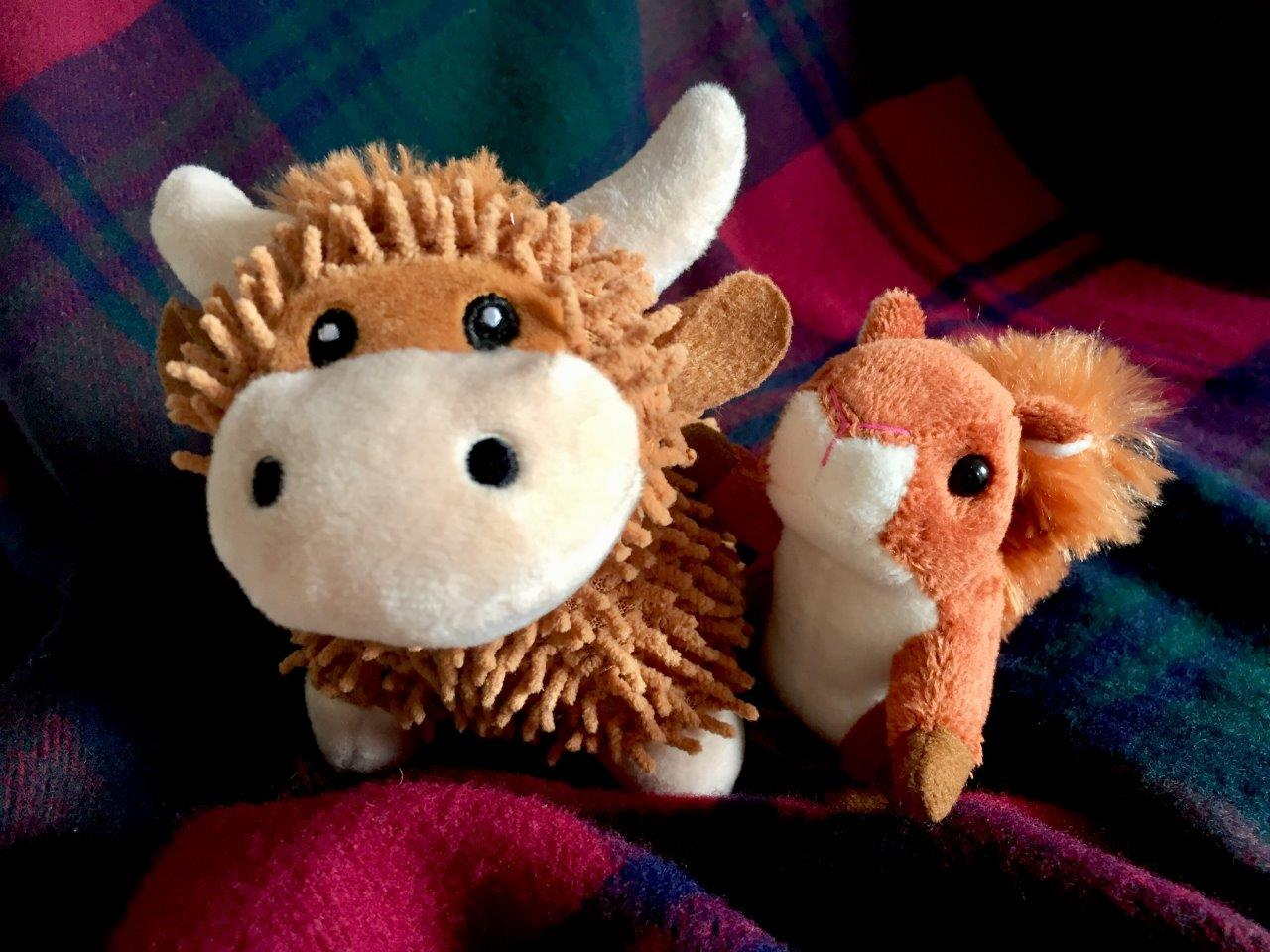 Toy highland cow and squirrel