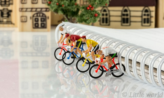 mini puppets cyclist contest isolated on white