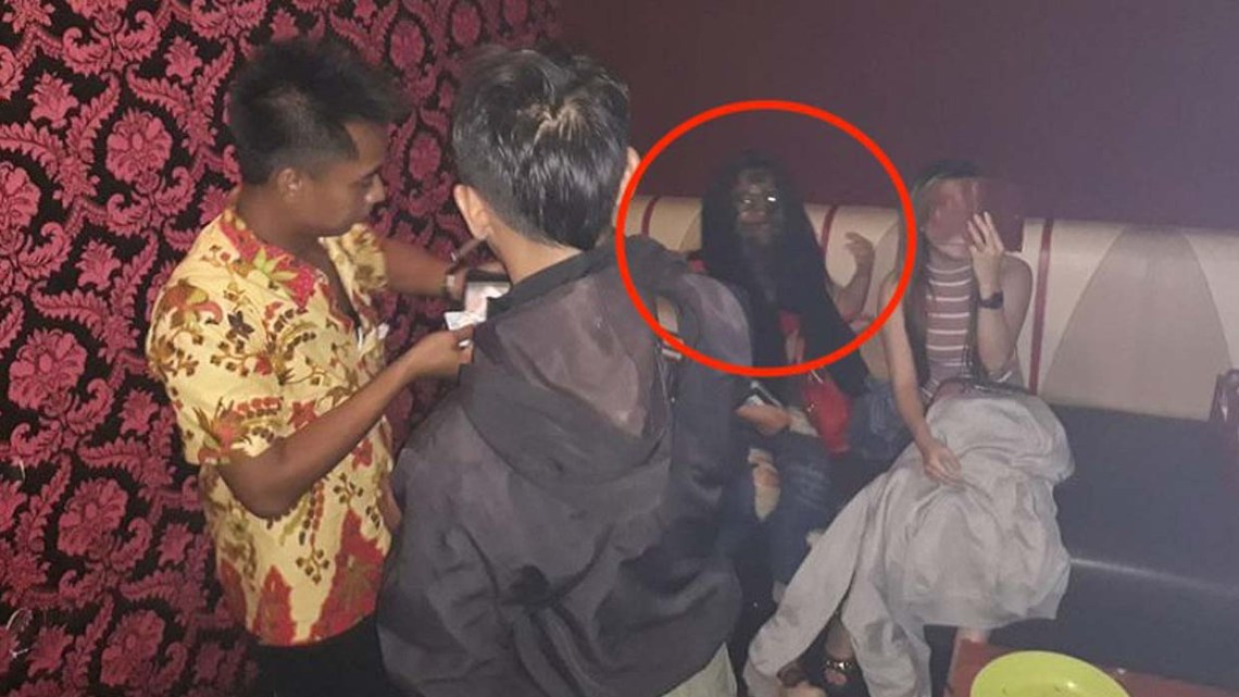 Spooky image shows a vampiric ghost during a raid in an Indonesian bar