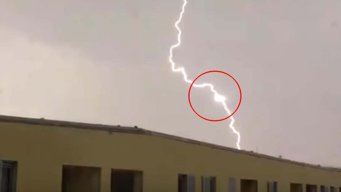 Photograph of a triangular UFO feeding the energy of lightning in the Czech Republic