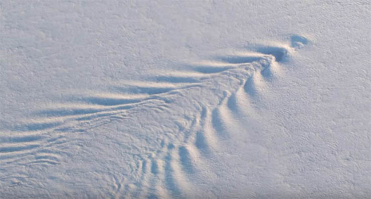 NASA images show mysterious waves in the clouds over Antarctica