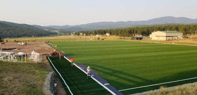 custom artificial grass installation of soccer field, football field
