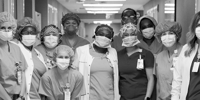 A group of medical staff wearing masks