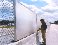 Sound Barrier Fencing Keeps Highway Noise out of Adjacent