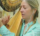 Elizabeth Hainen plays harp with earbuds