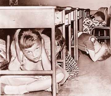 U.S. schoolchildren practice a duck and cover drill.