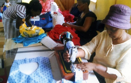 A Swazi lady sews blouses and teaches others
