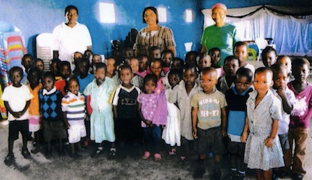 Pre-school children with their two mistresses and with Mrs Busi Vilakazi