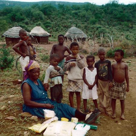 A grandmother receives food for her five vulnerable grandchildren (orphans)