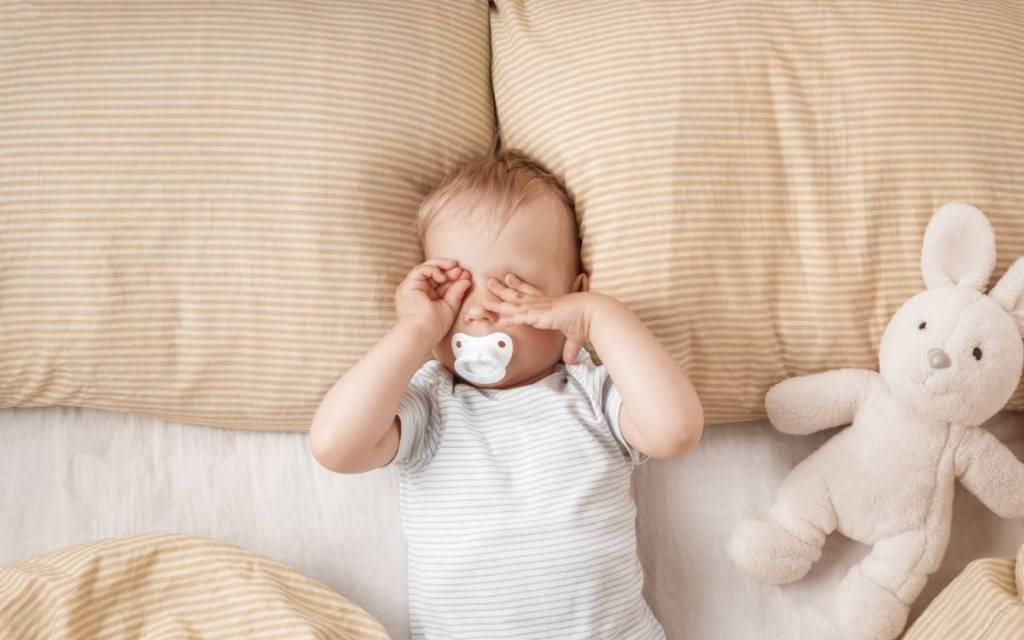 Baby: when to switch from sleeping bag to duvet?
