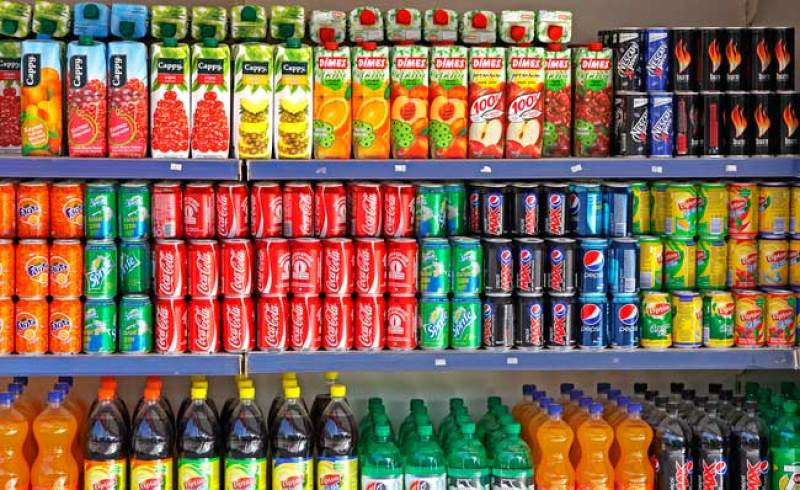 bigstock-Bottles-Of-Soft-Drinks-On-A-Ma-556813431