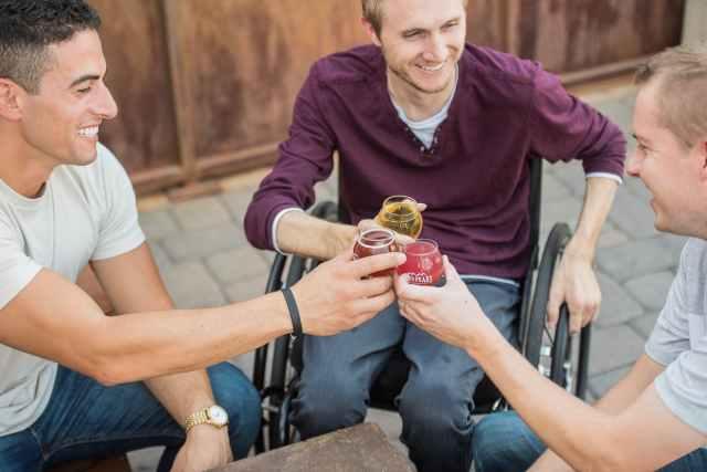 three guys having a toast