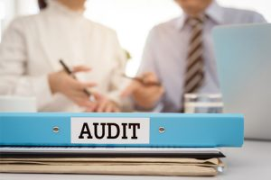 A company that provides NAPBS accredited background checks completes an audit to maintain their accreditation