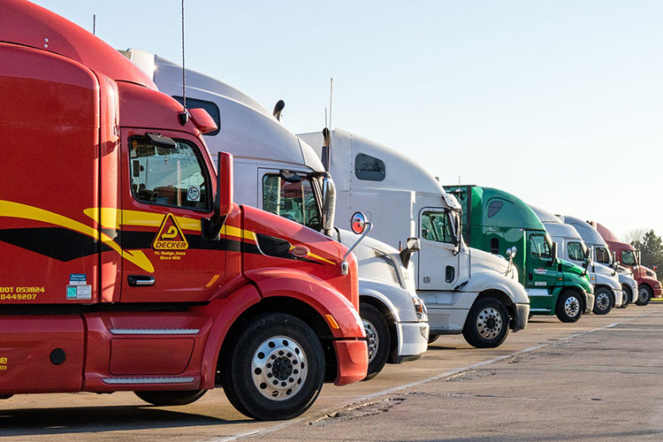 Semi-trucks in a parking lot