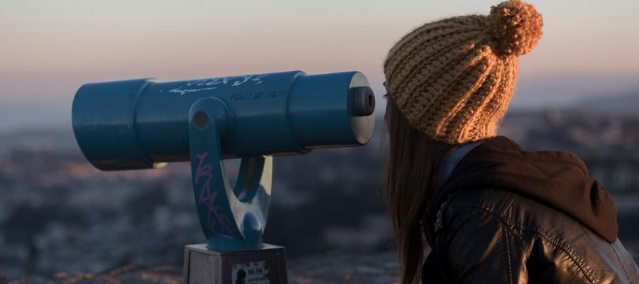 Image of Girl looking through binoculars