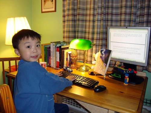 Eight years old David T. Lee writing his 2nd book of The Adventures of Danny Hoopenbiller series