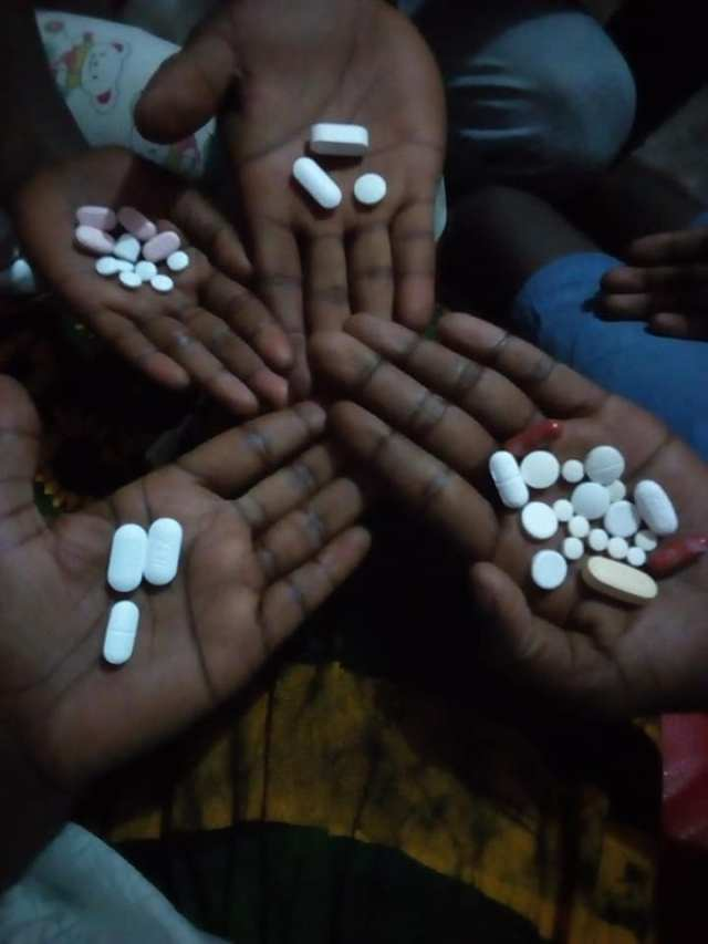 A woman who gave her name as Barbara Kemigisa has taken to the public space to display the HIV drugs that she is taking together with