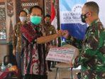 Bupati Semarang Mundjirin saat menerima penyerahan hasil bulan dana PMI 2020.