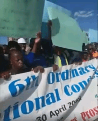 Workers march on Mutorwa