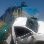 Three injured during collision with train