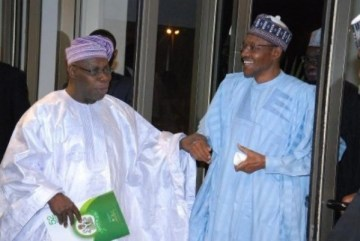BUHARI AND OBASANJO AT THE PRESIDENTIAL VILLA, ABUJA DURING THE CENTENARY ANNIVERSARY COMMENCEMENT DINNER