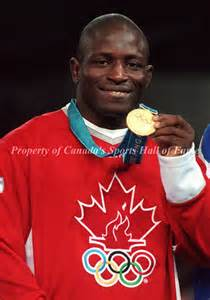 Daniel Igali Celebrates His Gold Medal Won AT the Sydney Olympic.