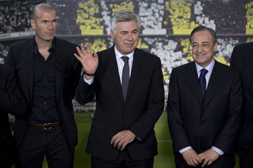 Ancelotti Waves During His Presentation as Real Madrid Manager In the Company of Zinedine Zidane and Florentino Perez.