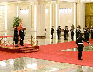 PRESIDENT GOODLUCK JONATHAN (L) AND CHINESE PRESIDENT XI JINPING (R) PREPARE TO INSPECT CHINESE HONOUR GUARDS DURING A WELCOMING CEREMONY AT THE GREAT HALL OF THE PEOPLE IN BEIJING ON JULY 10,2013. AFP PHOTO / WANG ZHAO/GETTY IMAGES