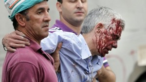 Train driver Francisco Jose Garzon Amo being helped from the site of the horrific train accident.