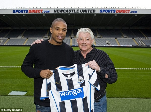 Loic Remy and Newcastle's Director of Football Joe Kieneer.