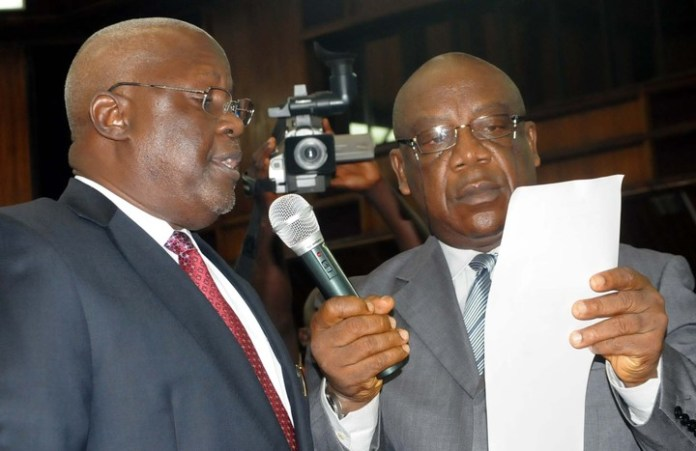 THE NEW CHIEF JUDGE OF THE FCT, JUSTICE IBRAHIM BUKAR (L), TAKING OATH OF OFFICE AT THE SWEARING-IN CEREMONY IN ABUJA ON FRIDAY