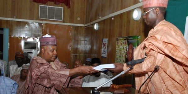 GOVERNOR KASHIM SHETTIMA OF BORNO STATE PRESENTING THE 2014 APPROPRIATION BILL TO THE SPEAKER OF THE HOUSE OF ASSEMBLY, HON. ABDULKAREEM LAWAN.
