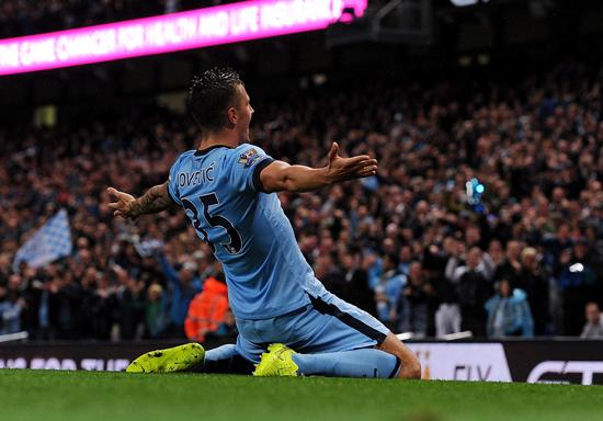 Jovetic Celebrates Scoring Against Liverpool at Anfield. Image: AFP