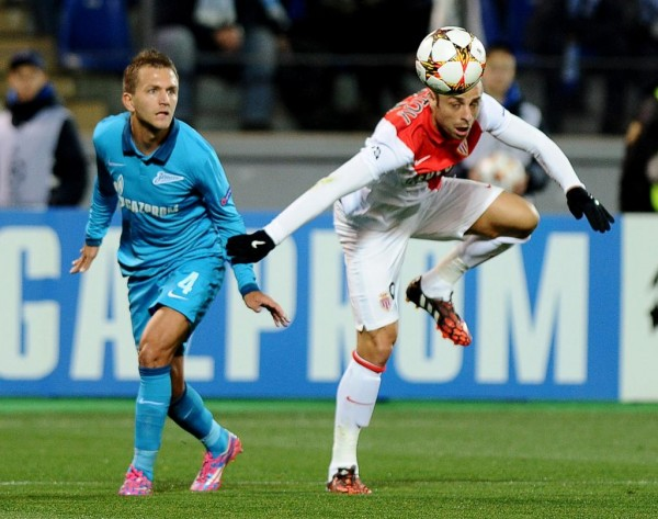 Dimitar Berbatov Tries a Header During a Champions League Group Game at Zenit St. Petersburg. Image: AFP.