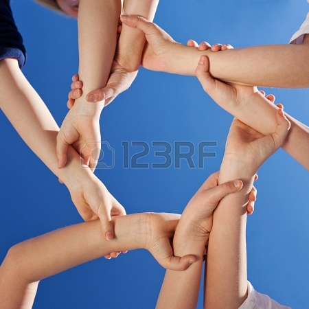 21223787-friendship--a-conceptual-image-of-the-hands-of-young-children-gripping-each-other-at-the-wrist-to-fo
