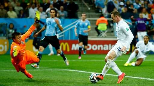 Wayne Rooney Scores his First World Cup Goal Against Uruguay During the 2014 Tournament. Image: Getty.