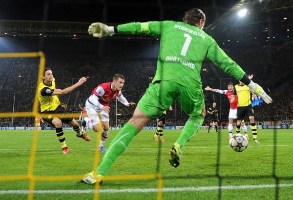 It Took an Aaron Ramsey Effort to Seal a 1-0 Win in Dortmund Last Season. Image: Arsebal via Getty.