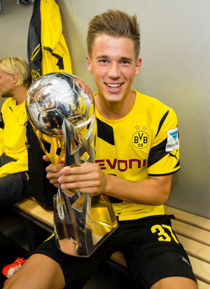 Erik Durm Celebrates Winning the 2014 German Supercup With Dortmund. Image: Alexandre Simoes/Borussia Dortmund/Getty