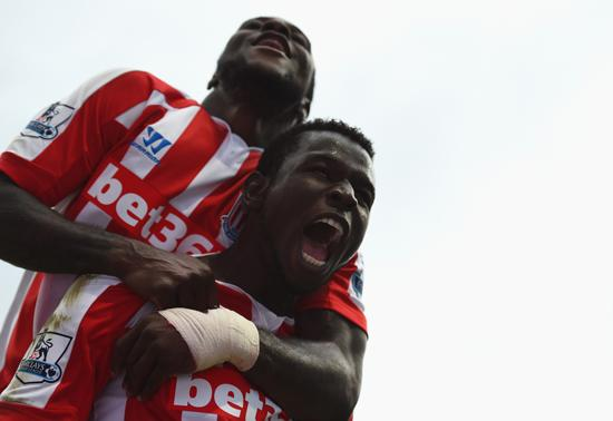 Mame Biram Diouf Celebrates With Victor Moses at the Etihad Stadium. Image: Getty.