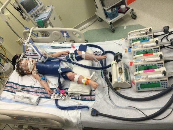 Eden Carlson at a hospital after near-drowning accident. (Courtesy of the Carlson family)
