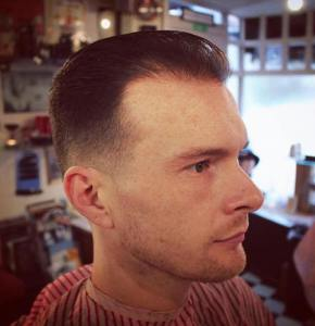 High and tight cut revealing forehead