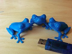 3D printed blue treefrogs in different layer t...