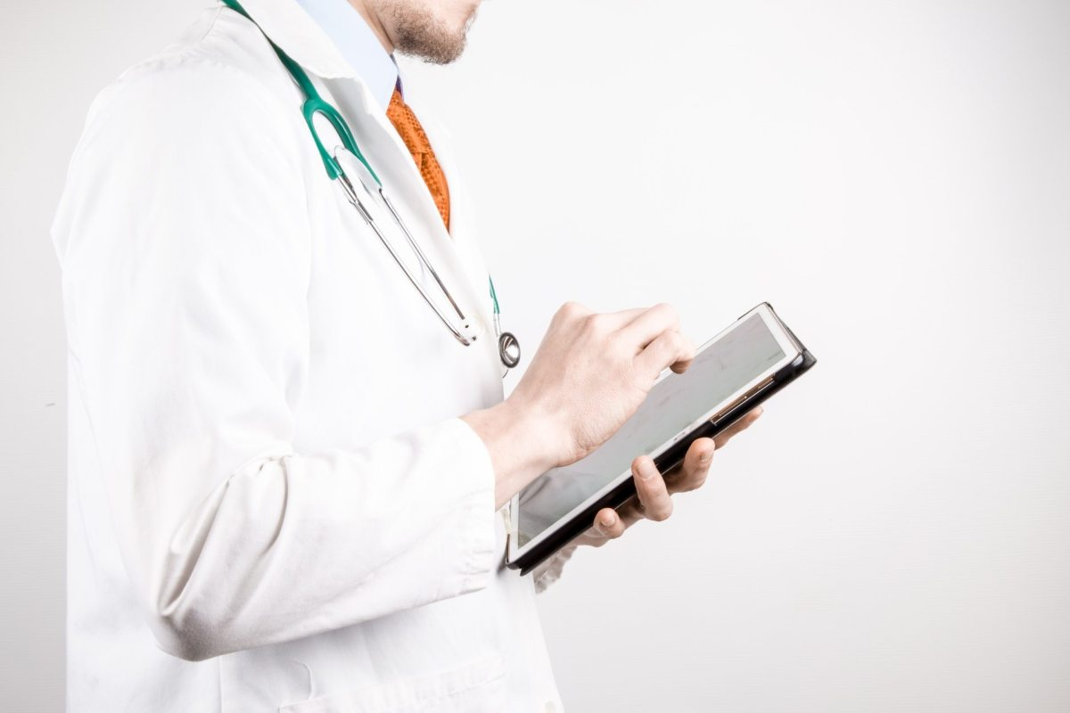doctor w/ tablet