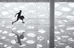 man running with briefcase