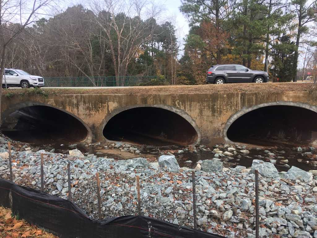 Three culverts with cars passing over