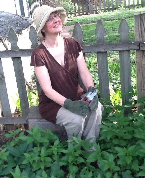 Kari Tauring has her gardening gloves on before collecting the nettles that surround her.