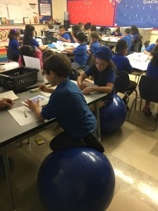 Students listening from desks