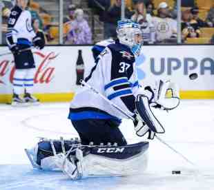 Connor Hellebuyck takes shots during warm up prior to a game against the Boston Bruins (InGoal photo by Scott Slingsby)