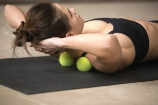 GettyImages-tennis-ball-stretch-Fizkes